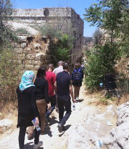 PNE participants touring the Palestinian village of Lifta.